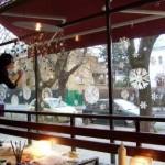 Community Snowflake painting on cafe window, Warsaw Poland