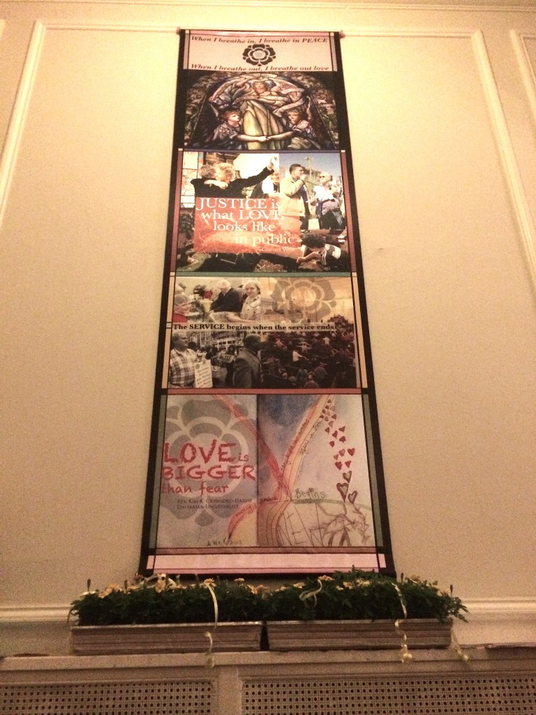 """Banner incorporating the mission of Arlington Street Church """"Gathered in LOVE and SERVICE for JUSTICE and PEACE"""""""